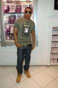 Nelly stops by Sugar Factory and checks out the couture pop section.