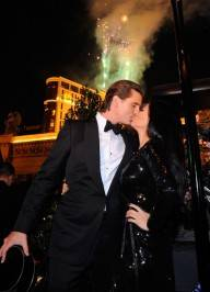 Kourtney Kardashian and Scott Disick share a New Year's Eve kiss at Chateau Gardens.