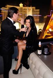 Kourtney Kardashian and Scott Disick toast the new year with sparkling cider at Chateau Nightclub & Gardens.