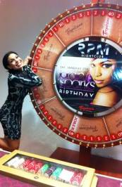 Jordin Sparks with the Tropican's Wheel of Jordin game.