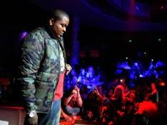Recording artist Sean Kingston asks for a moment of silence to honor singer Whitney Houston before he performed at the RPM Nightclub.