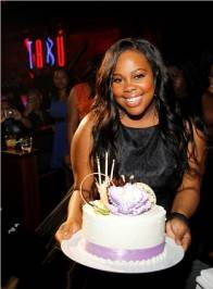 Amber Riley with her birthday cake at Tabu.