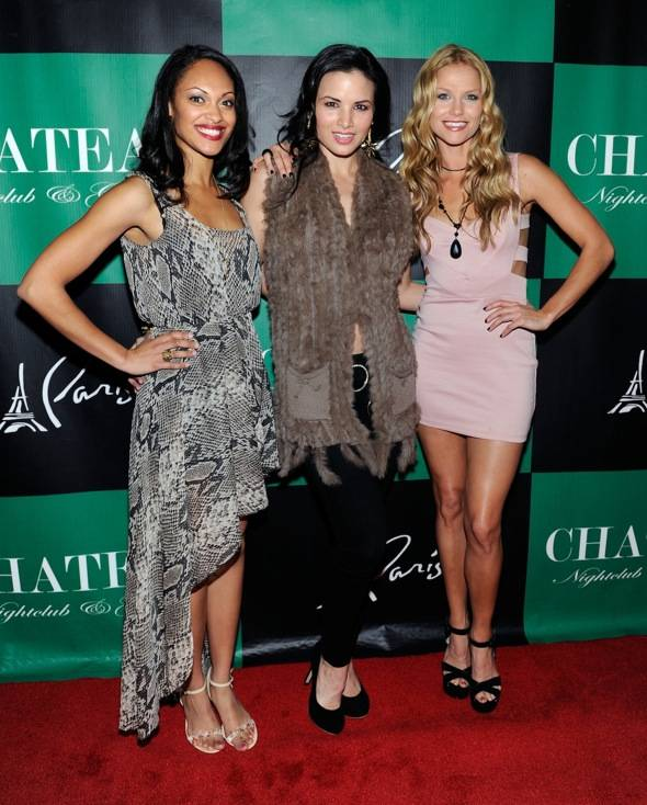 Cynthia Addai-Robinson, Katrina Law and Ellen Hollman pose on the red carpet for Chateau Nightclub & Gardens.