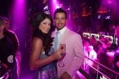 Laura Croft enjoys a little bubbly with her boyfriend Clint Scott as her party kicks off at Chateau Nightclub & Gardens inside Paris Las Vegas.