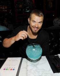 Kellan Lutz with an Oceans Blue goblet cocktail at Sugar Factory American Brasserie at Paris Las Vegas.