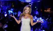 Brittney Palmer poses in front of dance floor of Gallery Nightclub.
