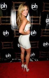 Brittney Palmer poses on Gallery Nightclub's red carpet.