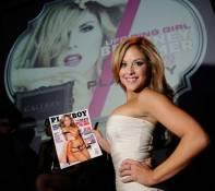 Brittney Palmer poses with her cover of Playboy Magazine inside Gallery Nightclub.