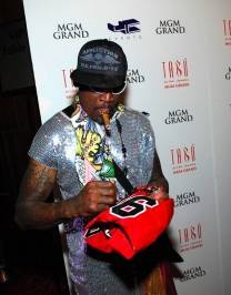 Dennis Rodman signs a jersey on the red carpet at Tabú Ultra Lounge.