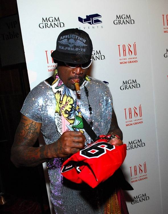 Dennis Rodman signs a jersey on the red carpet at Tabú Ultra Lounge at MGM Grand 3.17.12