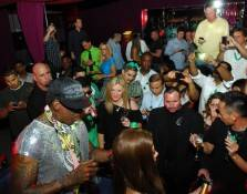 Dennis Rodman with fans inside Tabú Ultra Lounge.