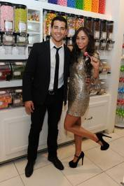 Jesse Metcalfe and fiancée Cara Santana at the flagship Sugar Factory retail store at Paris Las Vegas.