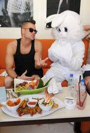 Mark Salling dines with the Easter bunny character at Liquid Pool Lounge at Aria.