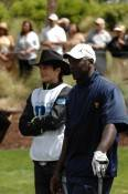 Ashton Kutcher acting as Michael Jordan's caddy.