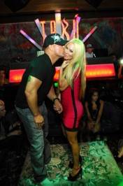 Jenna Jameson gets a birthday kiss from Tito Ortiz.