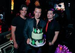 Brothers, Matthew and Andrew pose with Joey (center) as he is presented with his birthday cake at Chateau Nightclub & Gardens.