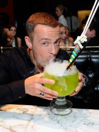 Joey Lawrence sips on 36-ounce Lollipop Passion Goblet.
