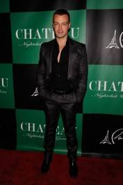 Joey Lawrence wears Gucci on the red carpet at Chateau Nightclub & Gardens.