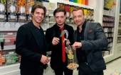 Matthew, Andrew and Joey Lawrence (L to R) pick out sweets at Sugar Factory's oversized candy bin wall.