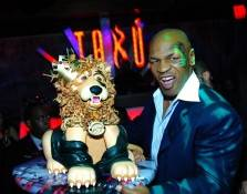 Mike Tyson growls with his lion cake.