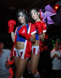 Tabú's go-go dancers as sexy boxers.