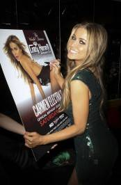 Carmen Electra signs her event poster for adoring fans at Crazy Horse III.