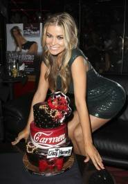 Carmen Electra shows off her Coca-Cola theme birthday cake at Crazy Horse III.