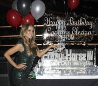 Carmen Electra poses with her birthday ice sculpture at Crazy Horse III.