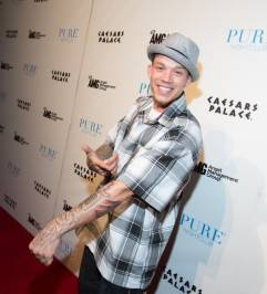 Chris Rene of The X Factor shows off his tattoos on the red carpet at Pure Nightclub.