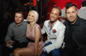Pasquale Rotelli, Holly Madison, Josh Strickland and Kaskade pose at their VIP table at Bazaar inside Chateau Nightclub & Gardens.