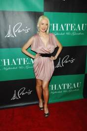 """Peepshow"" star Holly Madison poses on the red carpet at Chateau Nightclub & Gardens."