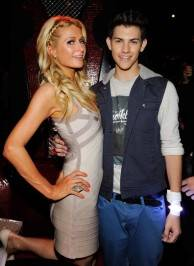 Paris Hilton and recording artist/model Nick Hissom attend Hissom's debut performance at the Tryst Nightclub.