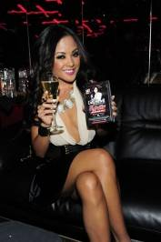 Kaylani Lei poses with sexy event flyer at Crazy Horse III.