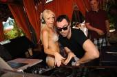 Gretchen Rossi hops in the deejay booth with DJ Jason Lema.