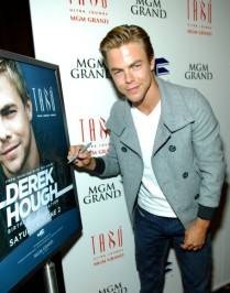 Derek Hough signs his poster.