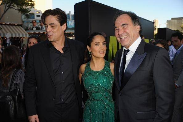 Benicio del Toro, Salma Hayek and Oliver Stone/Getty Images