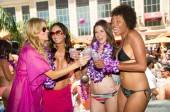 Brandi Glanville toasts her girlfriends with Hpnotiq Harmonie at Tao Beach.