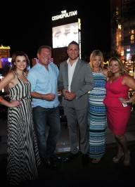 "Cosmopolitan CEO John Unwin (2nd from R), Curtis Stone (C) and Amy Rosetti (R) attend the ""Top Chef Masters"" Season 4 Premiere Party at the Cosmopolitan."