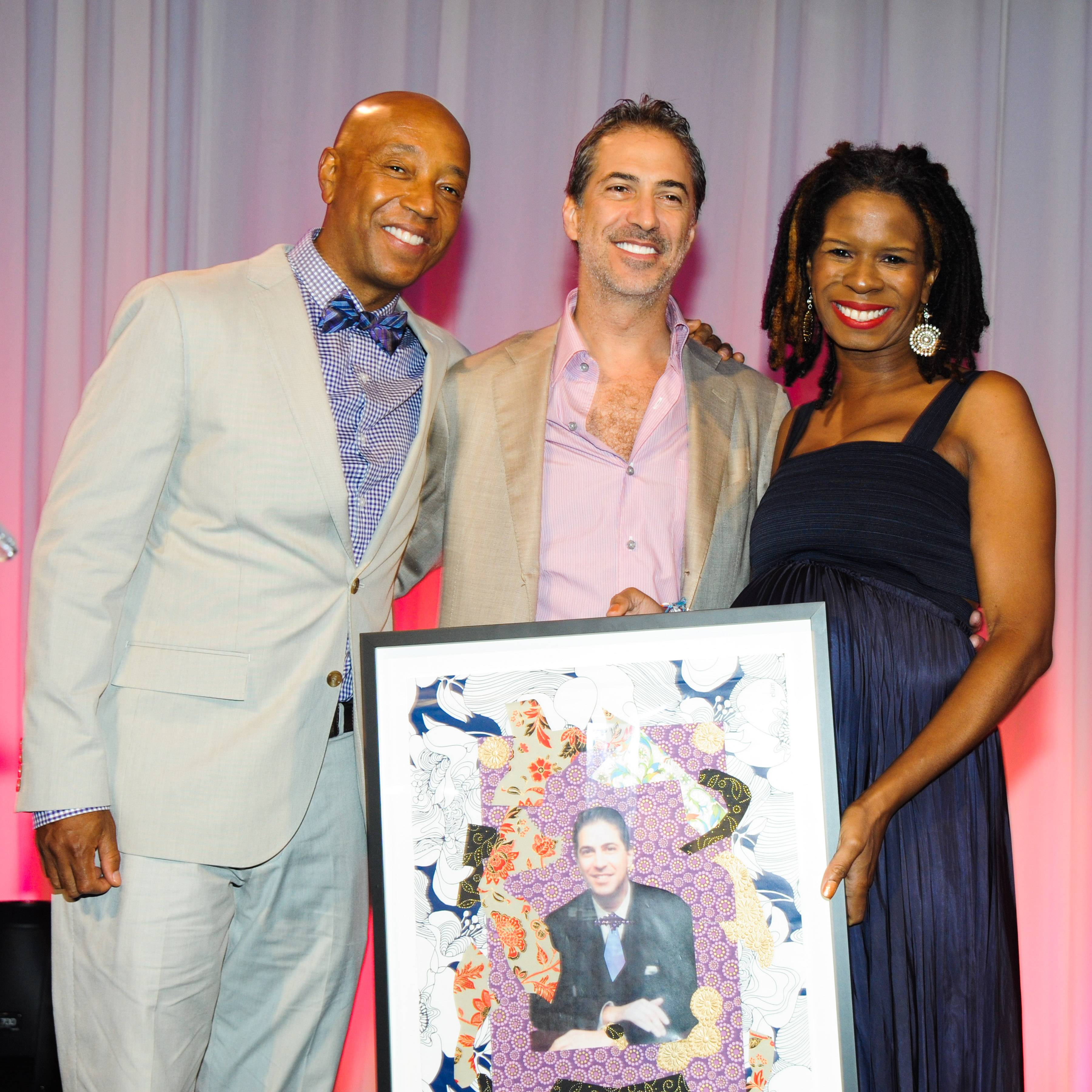Marc Leder, Tangie Murray, and Russell Simmons Accepting Award
