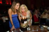 Maria Menounos and Katherine Jenkins blow out candles at Tao.