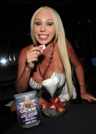 Mary Carey enjoys strawberries and whipped cream inside Crazy Horse III.