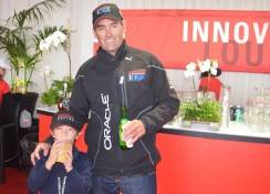 Russell Coutts relax with young fan Octavio Bindel after Day 4 races.
