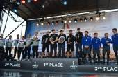 Award ceremony for Fleet Race winners Oracle Spithill, Luna Rossa Piranha and Team Korea.