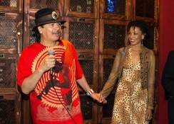 Carlos Santana addresses the crowd, toasting to his return to House of Blues for his Fall residency (wife Cindy Blackman)