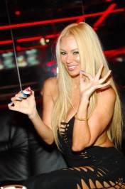 Jenna Jameson enjoys strawberries and whipped cream inside Crazy Horse III. Photos: Bryan Steffy/WireImage