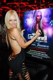 Jenna Jameson signs posters for fans inside Crazy Horse III.