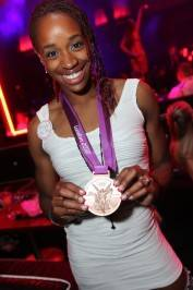 Olympian Janay DeLoach with her bronze medal at Rain Nightclub. Photos: Joe Fury