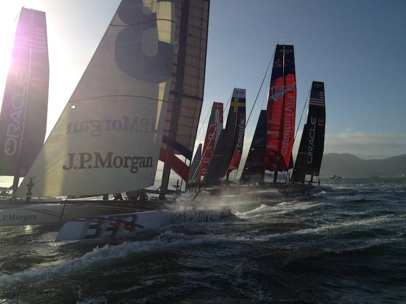 Fleet race rounding the first mark boat