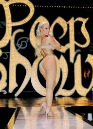 "Coco Austin appears on stage after her opening night performance of ""Peepshow"" at the Planet Hollywood Resort."