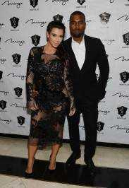 Kim Kardashian and Kanye West arrive for the New Year;s Eve countdown at 1 OAK Nightclub.